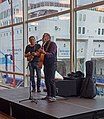 Entertainers in the departure hall for ferry to Denmark 1.jpg