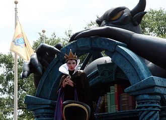 Evil Queen (Disney) - The Queen in her lair with magic books and a statue of the demon Chernabog from Fantasia at Share A Dream Come True Parade in 2008