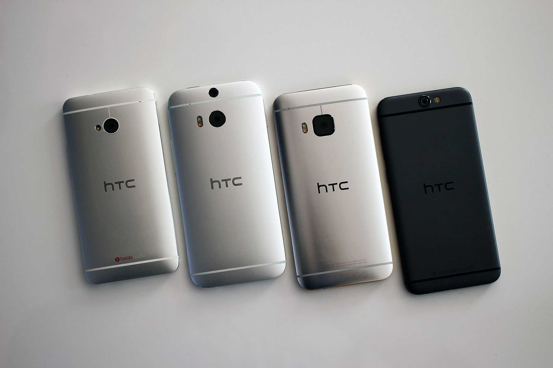 1920px Evolution of the HTC One M7%2C M8%2C M9%2C and A9 %2822167124478%29
