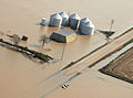 FEMA - 34643 - Aerial of agricultural storage units isolated by flood waters in Northeastern Arkansas.jpg