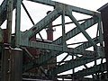 Fall River- Davol Street bridge truss with north and southbound Routes 79 and 138 roadway decks removed (13227514835).jpg