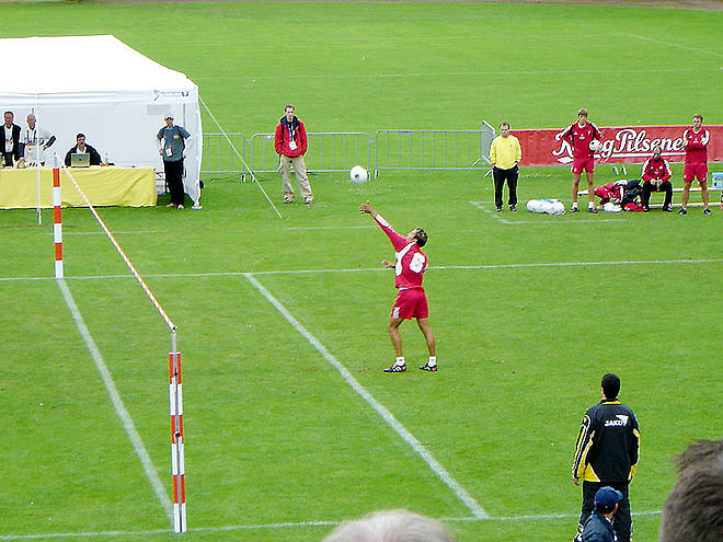 A fistballer prepares to serve the ball Fistball Server.jpg