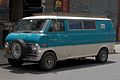 Ford Econoline with spare wheel mounted on grille.jpg