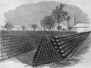 Close-packing of equal spheres - Cannonballs piled on a triangular (front) and rectangular (back) base, both fcc lattices.