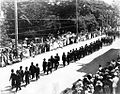 Funeral Procession of Liliuokalani - black figures marching.jpg