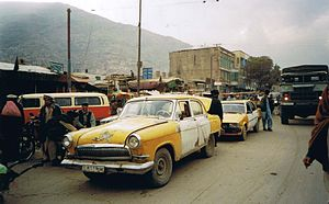 Taxicabs by country - GAZ-21 and Toyota Corolla E70 taxis in Kabul, Afghanistan
