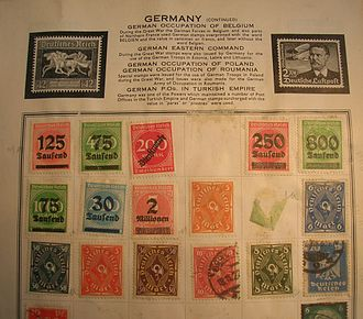 Stamp album - Preprinted page from a 1930s stamp album with printed spaces for non-specific mounting and includes information on each country