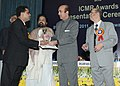 Ghulam Nabi Azad presenting the Basanti Devi Amir Chand prize to Dr. Manmohan Parida, at the ICMR awards presentation function, in New Delhi. The Minister of State for Health and Family Welfare.jpg