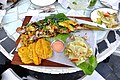 Grilled yellow snapper with green papaya salad and tostones.jpg
