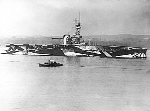 Naval tactics in the Age of Steam - The British carrier Furious in 1918, after she had been fitted with a landing-on deck aft, but still clearly showing her cruiser origins. Note the large crash barrier rigged behind her funnel and her dazzle camouflage.
