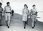 Habis Majali walking alongside Queen Alia, 1964.jpg