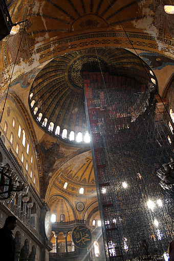 Interior of the Hagia Sophia under renovation, showing many features of the grandest Byzantine architecture.