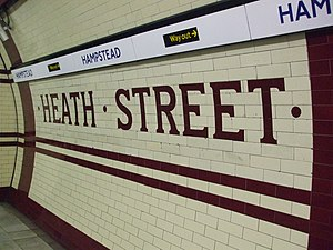 "Hampstead tube station - Tiling on the southbound platform, showing the original proposed name, ""Heath Street"""