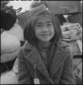 Hayward, California. A young member of an evacuee family awaiting evacuation bus. Evacuees of Japa . . . - NARA - 537510.tif