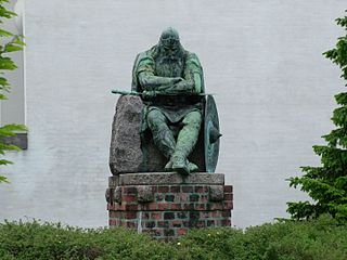 A bronze statue of the sleeping Holger in Helsingør in 2005