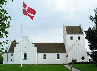 National church - A Church of Denmark parish church in Holte, with the Dannebrog flying in its kirkyard