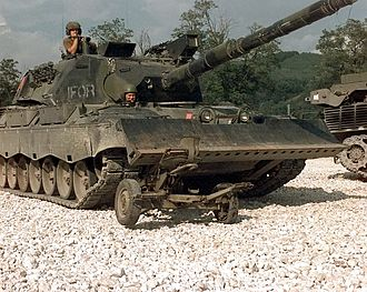 Operation Amanda - A Danish IFOR Leopard I tank crushing a decommissioned Serbian antiaircraft gun in 1996