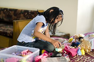 Barbie - Indian girl playing with Barbie dolls in Bangalore