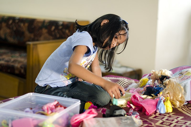 File:Indian girl playing with Barbie dolls in a gated middle-class community in Bangalore.jpg