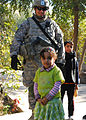 Iraqi children look up to Multi-National Division-Baghdad Soldiers during MND-B Commanding General's visit to Taji DVIDS145032.jpg