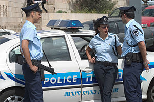 Israel Police - Israeli police officers and a patrol car
