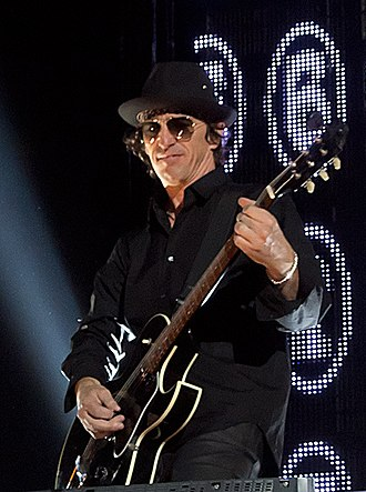 Izzy Stradlin - Stradlin performing at a Guns N' Roses concert in 2012
