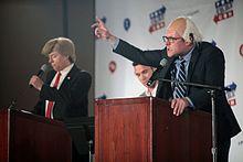 James Adomian (right) performing as Bernie Sanders, along with Anthony Atamanuik as Donald Trump at Politicon in Pasadena, California.
