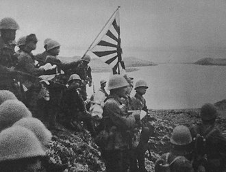 Aleutian Islands Campaign - Japanese troops raise the Imperial battle flag on Kiska Island in the Aleutians on June 6, 1942.