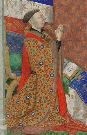 John of Lancaster, 1st Duke of Bedford - John of Lancaster, 1st Duke of Bedford, with his heraldic badges of wood stocks and his motto A Vous Entier  (miniature from Bedford Hours)