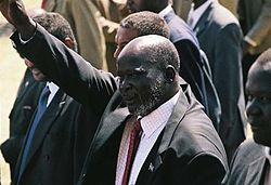 John Garang waving to the people