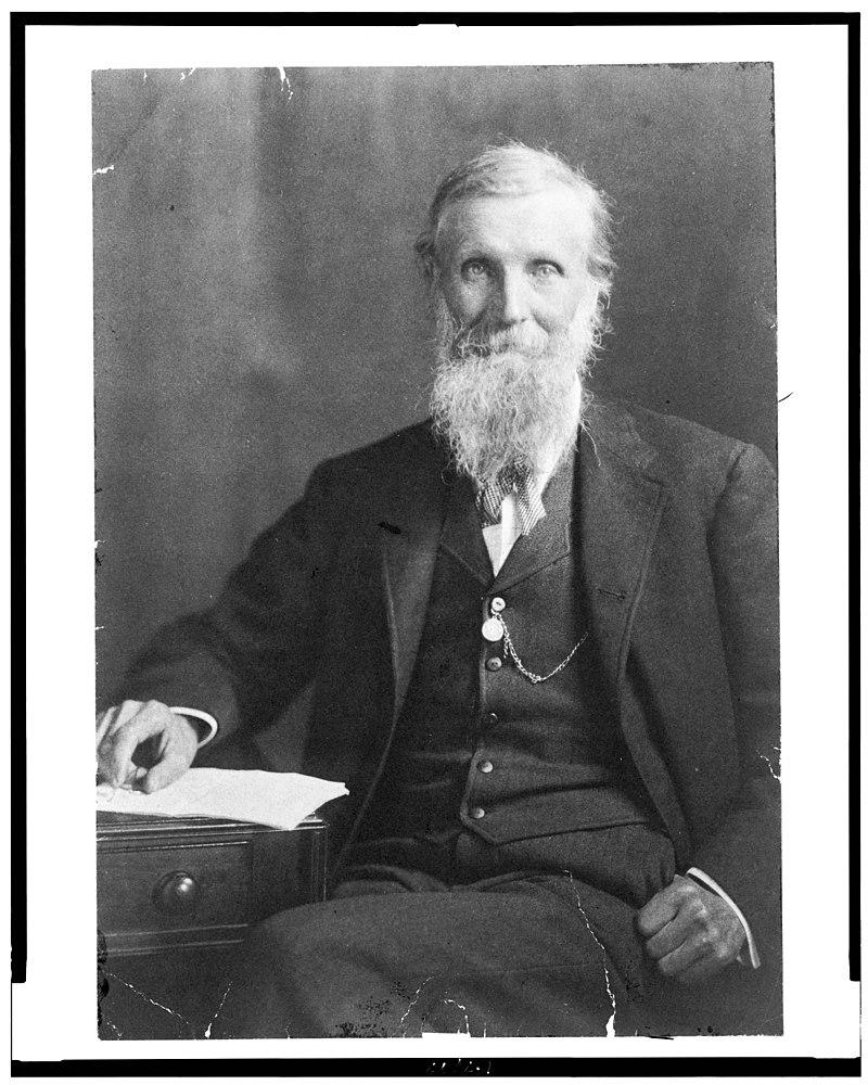 John Muir, three-quarter length portrait, seated, facing front LCCN93505505.jpg