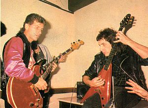 Johnny Rivers - Rivers (left) playing with Argentine guitarist Pappo, 1986