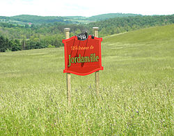 Settlement sign for Jordanville