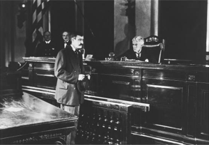 Warren Cook - Cook before Judge Landis in the government film The Immigrant (1917)