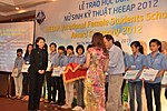 KC Choe of USAID Vietnam presents Female Vocational Student Scholarships (8379675503).jpg