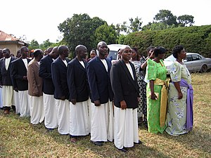 Kanzu - Men wearing kanzus at a wedding in Kampala, Uganda.