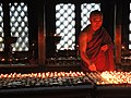 Kathmandu-Monk is lighting candles (Explored, 15-04-2015) - Flickr - ustung.jpg
