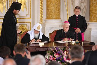Patriarch Kirill of Moscow - Kirill and archbishop Józef Michalik signing a joint declaration to the Polish and Russian people at the Royal Castle in Warsaw (2012)