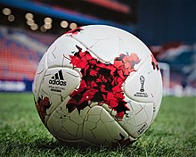 Football made of sewn together X shaped panels with a painted stylized small X in the middle of the panel. Also Printed on the ball is the name and logo for both Adidas and confederation cup 2017.