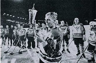 Frölunda HC - Team captain and playing coach Lars-Eric Lundvall hoisting the Le Mat Trophy when Frölunda won the Swedish Championship in 1965. Lundvall's jersey number 13 is retired by Frölunda.