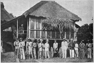 Siege of Baler - Filipino troops of Colonel Tecson in Baler, May 1899.  Tecson is to the right of the cannon, Novicio to the left.