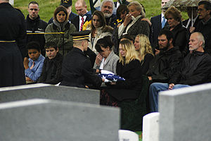 Leonard B. Keller - Keller's daughter accepts a folded flag during his burial ceremony at Arlington National Cemetery.