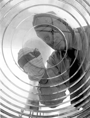 Pensacola Light - Lighthouse keeper cleaing the lens of the Lighthouse, circa 1960.