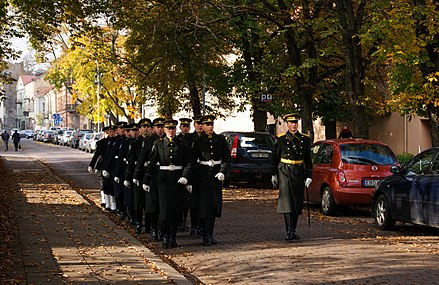 Lithuanian Army soldiers marching with their dress uniforms in Vilnius. An officer stands out with a sword. Lithuanian army in Vilnius (8123251773).jpg