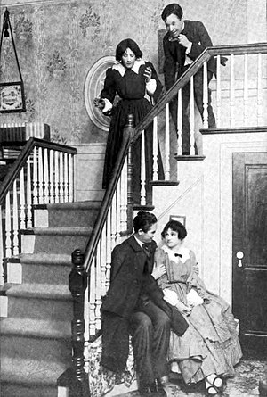 John Cromwell (director) - John Cromwell (seated) as John Brooke with Alice Brady as Meg in the Broadway production of Little Women (1912)