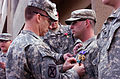 Lt. Col. Gregory Baine presents Army Commendation Medal to Spc. Christopher Halski 10th Mountain Division (2008).jpg