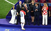 Luka Modric receives the golden ball prize at the hands of Russian President Vladimir Putin.jpg
