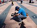 MNA Reporter Checking Television Camera on Plaza 20140906.jpg