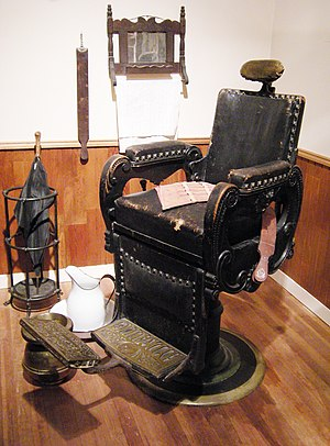 Barber chair - A barber chair in a recreation of J. N. Hooper's Barber Shop (Seattle, WA circa 1880s) at the Museum of History and Industry