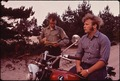 MOTORCYCLIST RECEIVES TICKET FOR RIDING ON THE NATIONAL SEASHORE PARK SAND DUNES - NARA - 545134.tif